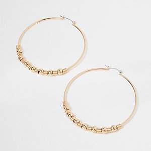 Gold tone ball hoop earrings