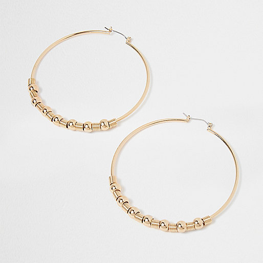 Gold tone ball hoop earrings