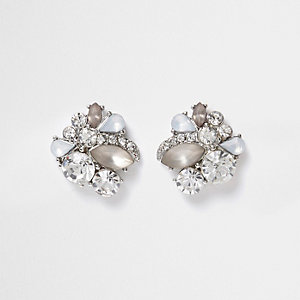 Silver tone rhinestone and stone stud earrings
