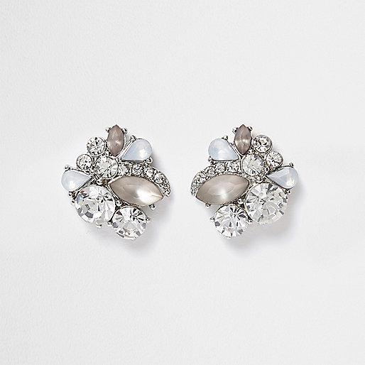 Silver tone rhinestone and stone stud earrings