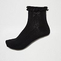 Chaussettes en maille torsadée noires à volant et nœud