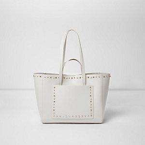 Crème leren handtas met zij-inzetten en studs