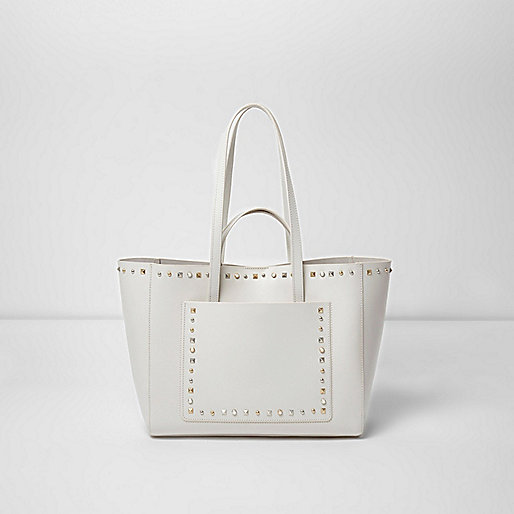 Cream leather studded winged tote bag