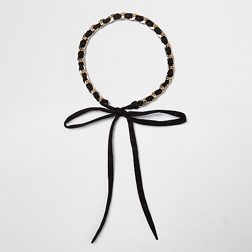 Black thread through gold chain bolo choker