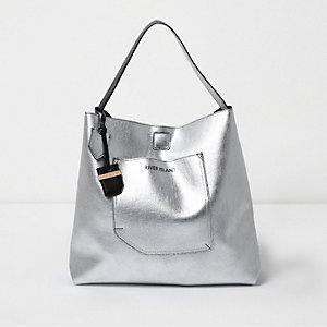 Zilverkleurige metallic omkeerbare onderarmstrandtas