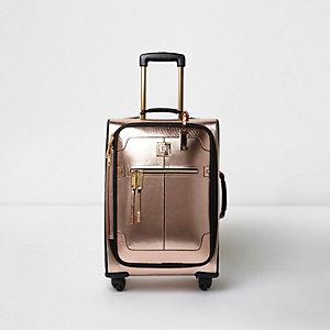 Metallic roségouden koffer met vier wielen