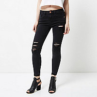 Petite black Amelie ripped super skinny jeans