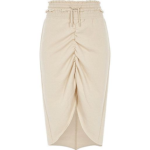 Beige jersey rok met rimpeling en langere achterkant