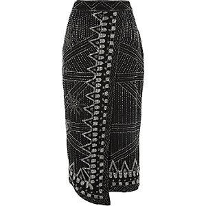 Jupe crayon noire ornée de perles style portefeuille