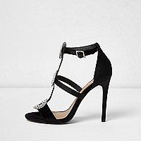 Sandales noires effet cage ornées de strass