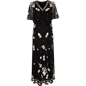 Zwarte met lovertjes verfraaide maxi-jurk met mesh en capedetail