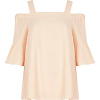 Light pink cold shoulder bell sleeve top