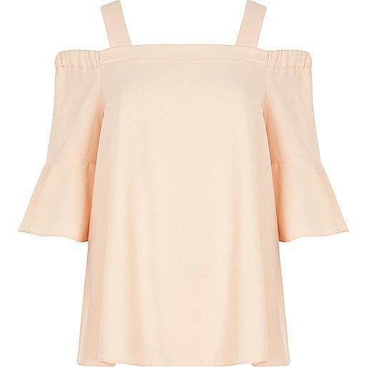 Light pink cold shoulder bell sleeve top