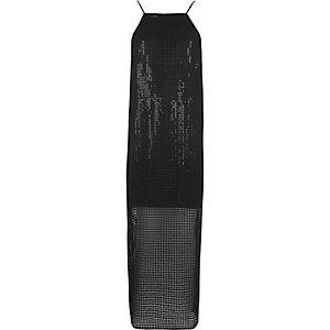 Robe longue noire à fines bretelles et sequins