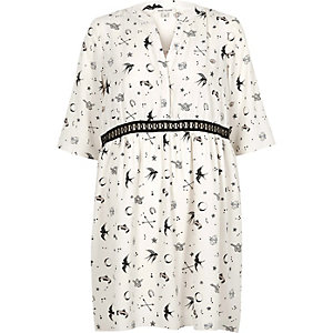 Cream tattoo print smock swing dress