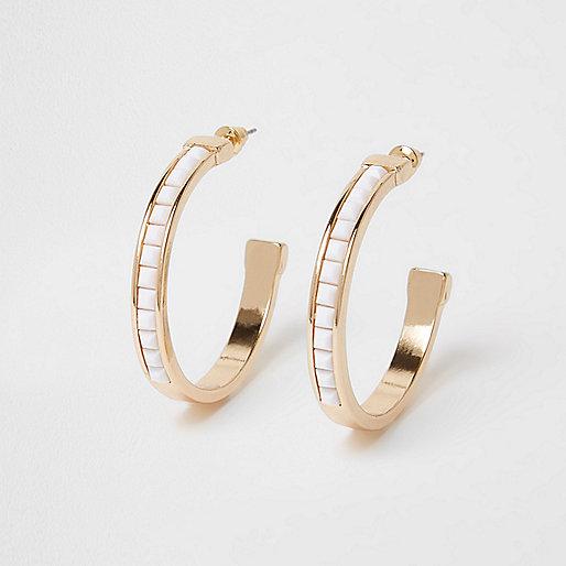 Gold tone resin hoop earrings