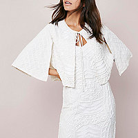 White embroidered sequin cape