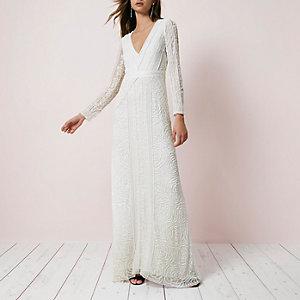 Crème maxi-jurk met lovertjes en lange mouwen