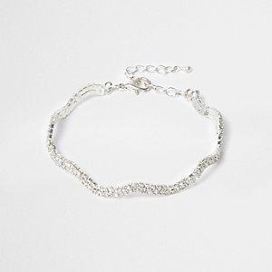 Silver tone wavy rhinestone encrusted bracelet