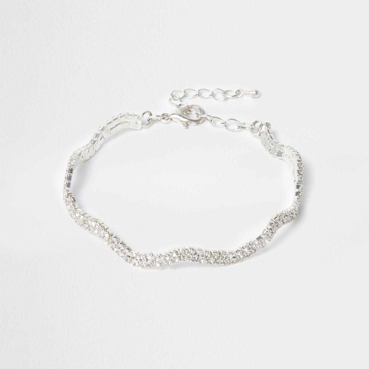 Silver tone wavy diamante encrusted bracelet