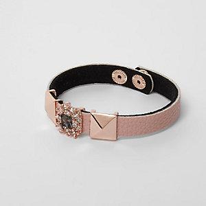 Bracelet or rose orné de clous et de strass