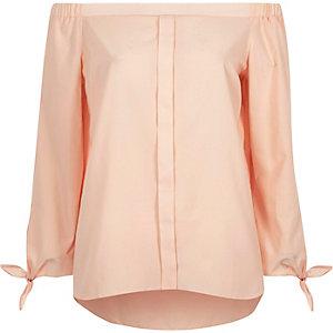 Roze bardotoverhemd met strik aan de mouwen