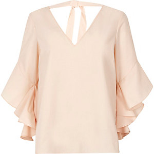 Light pink frill sleeve tie back top