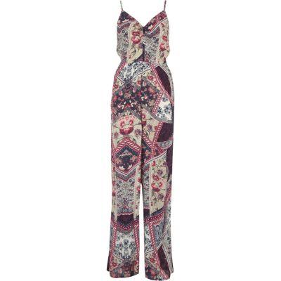Paarse jumpsuit met wijde pijpen en bloemenprint