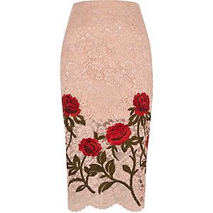 Jupe crayon en dentelle rose clair avec fleurs brodées