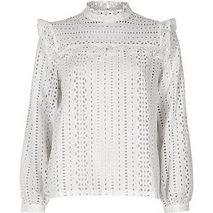 White broderie frill bib blouse