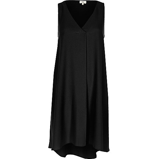 Black sleeveless pleat swing dress