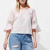 Petite pink crochet bell sleeve top