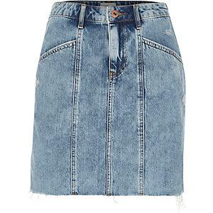 Jupe en jean bleue à taille haute et empiècements