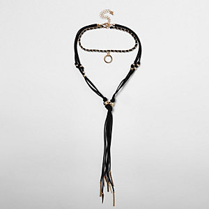 Black gold tone charm tassel bolo necklace