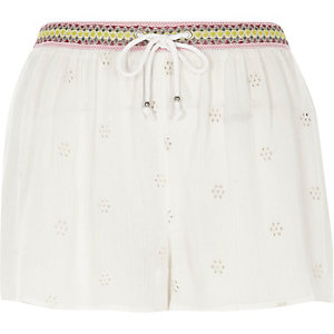 Cream embroidered beach shorts