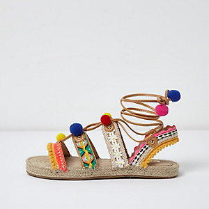 Pink pom pom tie up espadrille sandals