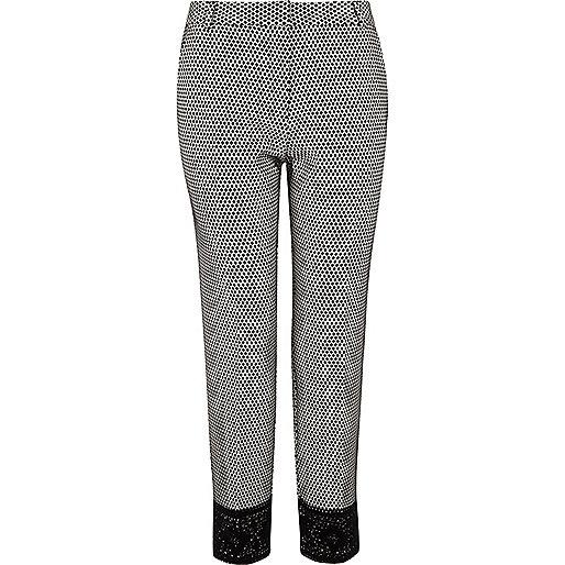 Black mono geo lace hem cigarette trousers