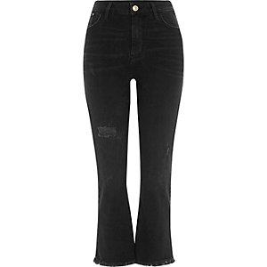 Schwarze, ausgestellte Jeans