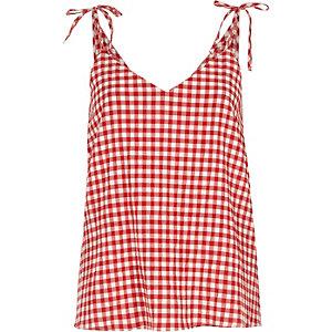 Caraco à carreaux rouge avec nœud sur l'épaule