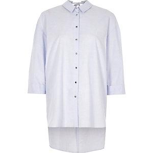 Chemise oversize bleue à dos ouvert