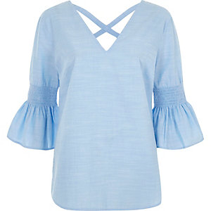 Light blue chambray shirred bell sleeve top