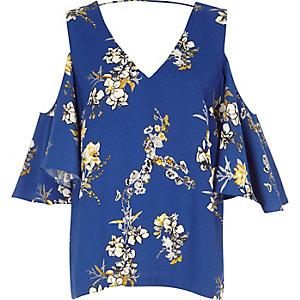 Top à fleurs bleu à épaules dénudées avec volant