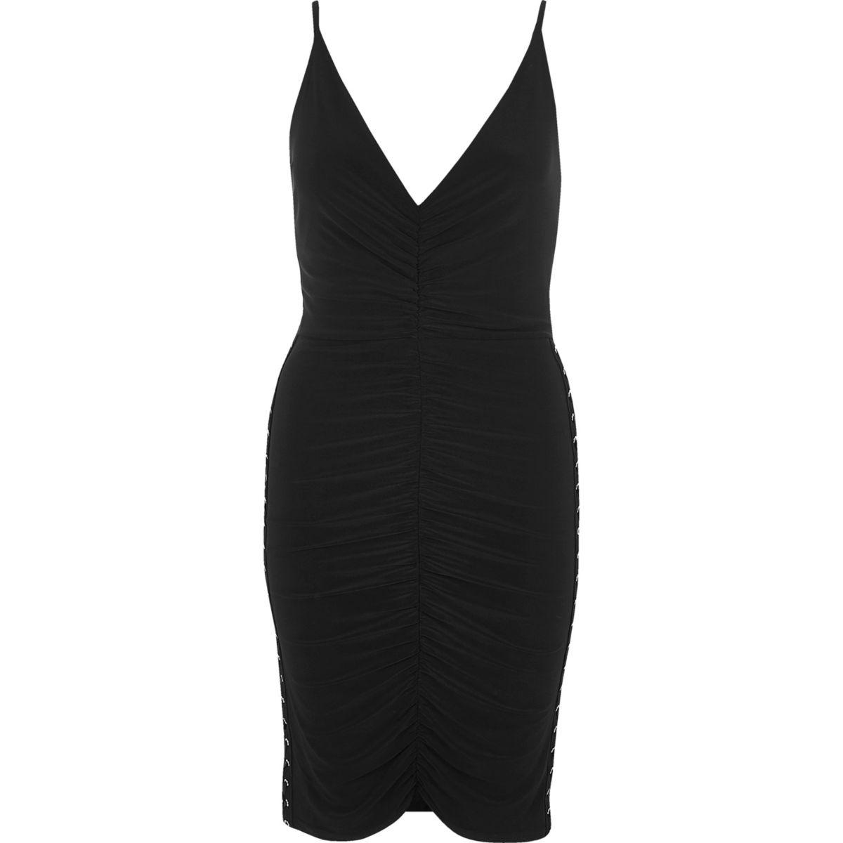 Zwarte jurk met corsetsluiting opzij en ruches