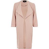 Manteau rose à pans avec boutons-pression