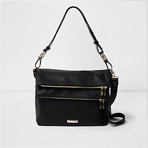 Schwarze Beuteltasche mit zwei Reißverschlusstaschen