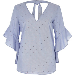 Blue spot print frill sleeve tie back top