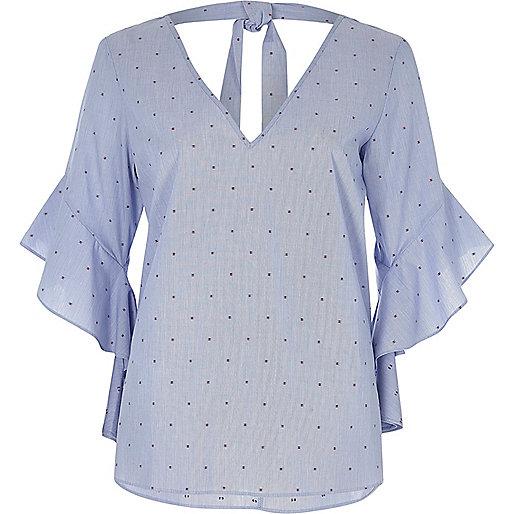 Blue spot print frill sleeve tie back top