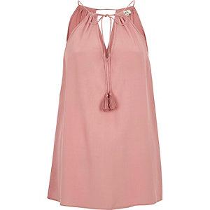 Roze mouwloze top met kanten zijkant en strik in de nek