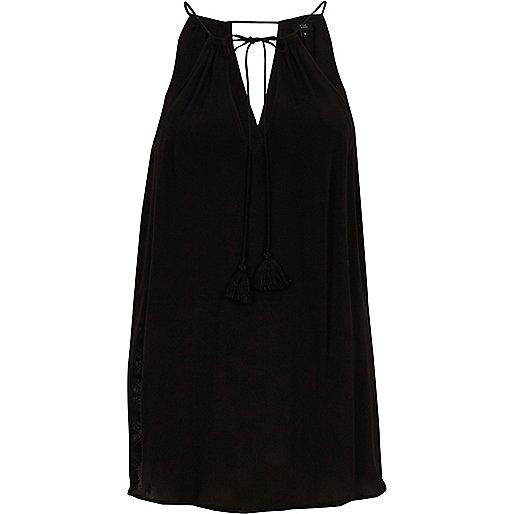Zwarte mouwloze top met kanten zijkant en strik in de nek