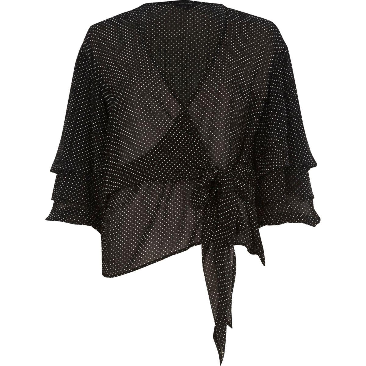 Zwarte gestippelde blouse met strik voor en pofmouwen